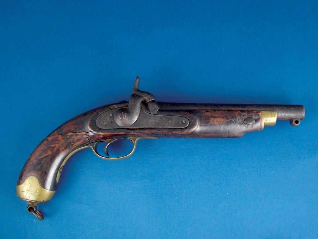 Pistola Inglesa de avancarga, sistema de percusión, fabricada Barnett - London.
